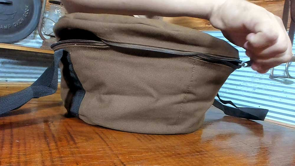 place camp oven in bag and zip up