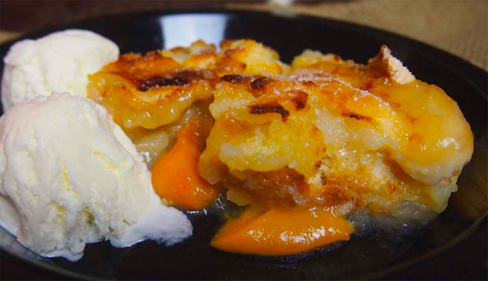 a photo of peach and apple cobbler